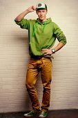 Full length portrait of a handsome young man in casual clothes. Studio shot.