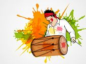 Young man playing drum on splash background for Indian festival of colors, Holi and Dolyatra celebration.