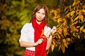 Schoolgirl In Red Skirt,  White Blouse And  Scarf