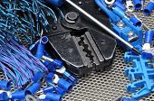 foto of electrician  - Tools for electricians crimpers and accessories on metal sufrace - JPG