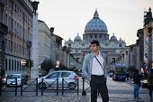 Young Man Standing In Front Of St. Peter's Square, Vatican City