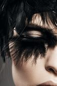 Macro Portrait Of Woman Eye With Black Feather