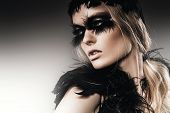 Sensual Woman With Black Feathers On Eyes