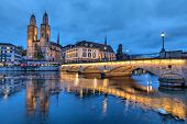 picture of zurich  - Munsterbrucke and Grossmunster church reflecting in river Limmat Zurich Switzerland - JPG