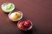 Adjika,mustard,wasabi In A Glass Bowl