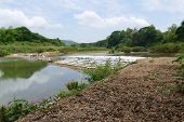stock photo of dam  - collapsing dam in the river in countryside of thailand - JPG