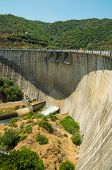 picture of dam  - Large concrete reservoir dam surrounded by forest - JPG