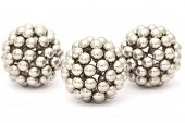 Three Balls Of Metal Segment Assembled From Neocube Isolated On White, Full View