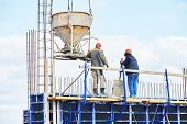 stock photo of concrete pouring  - concreting work - JPG