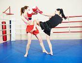 foto of muay thai  - muai thai women fighting at training boxing ring - JPG