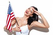 stock photo of independent woman  - Sexy woman salute with USA flag independence day - JPG