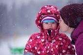 stock photo of snow-slide  - happy family on winter vacation - JPG