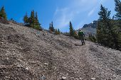 foto of ling  - man walking along narrow and steep gravel path to climp up on ha ling peak in banff canada - JPG
