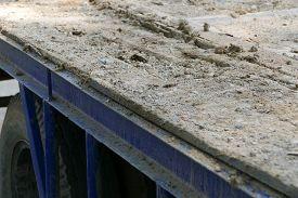 pic of dumper  - dirt on the old blue truck dumper for construction - JPG