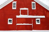 red barn facade in white snow