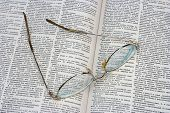 Glasses On Opened Book (Dictionary)