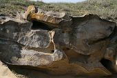 stock photo of peculiar  - Peculiar erosion shapes on sandstone - JPG