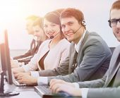 customer service representative with headset in call center poster