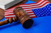 Notebook, gavel and American flag on table. Legal immigration poster