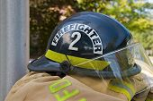 firefighter helmet on coat