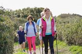 Senior people nordic walking by the atlantic coast poster