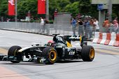 PUTRAJAYA, MALAYSIA - APRIL 2: Team Lotus test driver drives around the streets of Putrajaya at the F1 Street Demo promoting the Petronas Malaysian F1 Grand Prix on April 2, 2011 Putrajaya, Malaysia.
