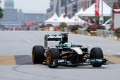 PUTRAJAYA, MALAYSIA - APRIL 2: Heikki Kovalainen of Team Lotus drives on the streets of Putrajaya in