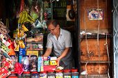 KUALA LUMPUR - MAY 22: A storekeeper watches over his traditional grocery store on May 22, 2011 in K