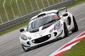 SEPANG - JUNE 17: Bruce Lee (18) from the USA in a Lotus Exige takes to the tracks of the Sepang Int