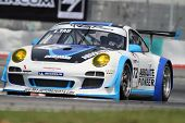 SEPANG - JUNE 17: Eddie Yau of Hong Kong in a Porsche 911 GT3R takes to the tracks of the Sepang Int