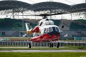 SEPANG - JUNE 17: A rescue helicopter from the Fire Department flies in on standby evacuation in the