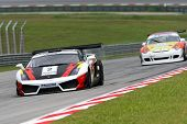 SEPANG - JUNE 17: Tunku Hammam Sulong of Arrows Racing in a Lamborghini LP560GT3 takes to the tracks of the Sepang International Circuit at the GT Asia Series race on June 17, 2011 in Sepang, Malaysia