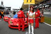 SEPANG - JUNE 19: Grid girl carries placard for the Jimgainer #11 team at the starting grid of the S