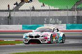 SEPANG - JUNE 19: 'GSR&Studie with Team UKYO' car takes turn one of the Sepang International Circuit