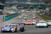SEPANG - JUNE 19: GT cars take off on a rolling start at the Japan SUPER GT Round 3 race at the Sepa