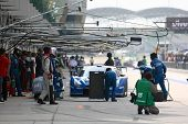 SEPANG - JUNE 19: Pit crew works on Team Impul's Nissan GT-R R35 car during the practice round of th