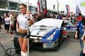 SEPANG, MALAYSIA - JUNE 19: Kondo Racing's race queen poses in front of the team's car at the Sepang International Circuit at the start of the Japan SUPER GT Round 3 race on June 19, 2011 in Sepang, Malaysia.