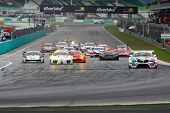 SEPANG - JUNE 19: Race cars take off from a rolling start in the GT300 race of the Japan SUPER GT Ro