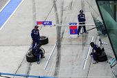 SEPANG - JUNE 19: Team Kunimitsu's pit-crew prepares for car to refuel, driver and tire change durin