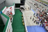 SEPANG, MALAYSIA - JUNE 19: Winners of the GT300 SUPER GT race pose on the podium and celebrate with