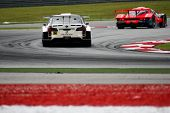 SEPANG, MALAYSIA - JUNE 18: The Lexus IS350 car of Team SG Changi takes to the tracks of the Sepang