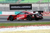 SEPANG, MALAYSIA - JUNE 18: The Nissan GTR car of NISMO team spins during early practice in the Sepa
