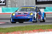 SEPANG, MALAYSIA - JUNE 18: The Porsche car of Samurai Team Tsuchiya puts in some practice laps in t