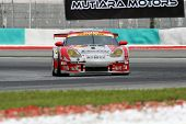 SEPANG, MALAYSIA - JUNE 18: The Porsche car of Team Taisan Cinecitta puts in some practice laps in t