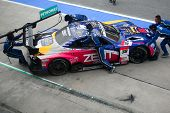 SEPANG - JUNE 18: The pit crew of Lexus Team Zent Cerumo pushes back the car into the garage in the