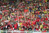 BUKIT JALIL, MALAYSIA - JULY 13: Soccer fans cheer during the Arsenal vs Malaysia game in the Nation