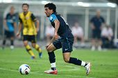 BUKIT JALIL - JULY 13: Arsenal's Carlos Vela (blue) prepares to shoot at goal on July 13, 2011 in Stadium Bukit Jalil, Malaysia. English league team Arsenal is on an Asia Tour playing Malaysia.