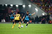 BUKIT JALIL - JULY 13: Arsenal's midfielder Aaron Ramsey attempts a pass against Malaysia  on July 13, 2011 in Stadium Bukit Jalil, Malaysia. English Premier League team Arsenal is on an Asia Tour.