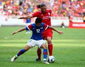 BUKIT JALIL, MALAYSIA - JULY 16: Malaysia's Amar Rohidan (12) blocks Liverpool's Andy Carroll in their game at the National Stadium on July 16, 2011, Bukit Jalil, Malaysia. Liverpool won 6-3.