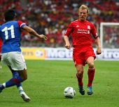 BUKIT JALIL, MALAYSIA-  JULY 16: Liverpool's Dirk Kuyt controls the ball in the game against Malaysi